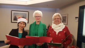 Three of our dedicated members singing carols at Jubilee House