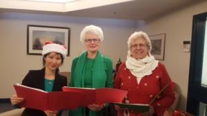 Three of our dedicated members singing carols at Jubilee House